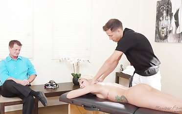 Stunning blond milf Carmen Caliente is fucked by masseur in front of husband