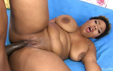 Chubby ebony woman loads her fat cunt with a generous BBC