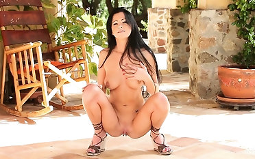 Sexy brunette babe having hot patio fun with her bald pussy palace