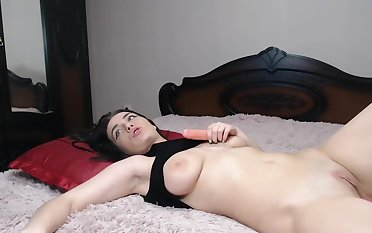 beautiful woman with double dildo penetrating and masturbating in lie alongside