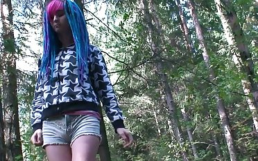 Blue haired alternative piece of baggage is accessible to piss into the open air in the country