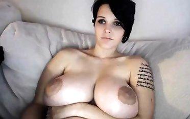 Bosomy MILF toys her pussy on webcam