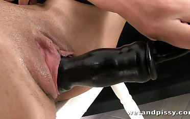 Wet haired piss affectionate slut shoves her sex toy into her pee soaked twat
