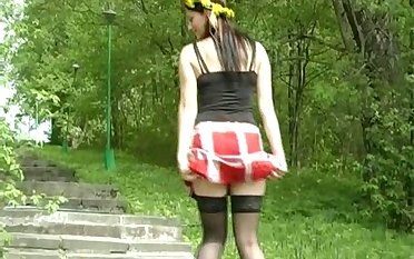 Pallid bitch in black nylon stockings is enthusiastic to pee outdoors