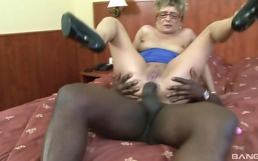 Blonde granny in blue fucking her vivacious black lover boy