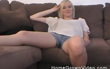 Gorgeous blonde teen gets her wet cunt banged on the couch