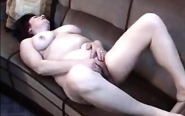Busty brunette mature rubs their way hairy cunt