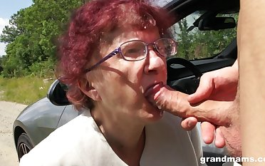 Kinky granny gives a blowjob and tugjob to one spoiled young pauper