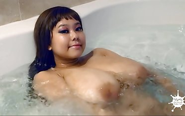 Asian babe with huge melons in the bathtube