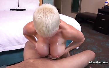 Short haired, blonde woman with blue eyes is sucking cock and licking those obese balls