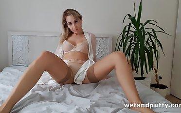 Alone effusive and beautiful hottie more beige stockings Siya masturbates pussy