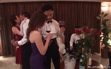 Japanese wife drops on her knees to be fucked during a party