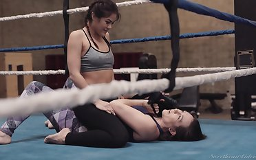 Lady wrestlers Sinn Astucious and Kendra Spade use a strap-on close to the ring