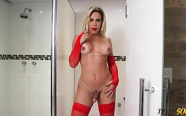 Zealous super curvy shemale in red stuff Raphaella Cardoso masturbates in toilet