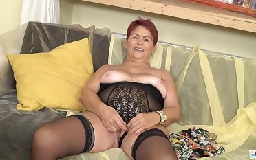 Red haired, Czech granny is wearing erotic, black underwear and playing in all directions a sexual connection toy