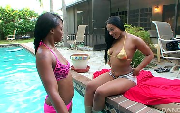 Poolside pleasures for ebony lesbians Carmela Mulatto and Trina Boss