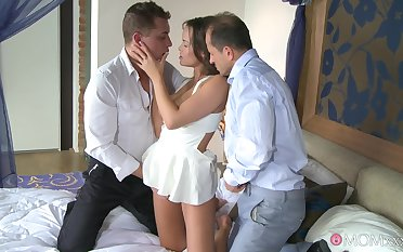 Busty babe deals with two dicks connected with charming lodging threesome