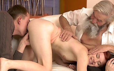 Super hot redhead fucked by boyfriend and his dad