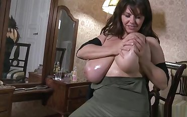 Winsome breasty doyenne lady in ultra glam fetish fun